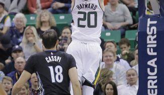 Utah Jazz forward Gordon Hayward (20) dunks the ball as Minnesota Timberwolves forward Omri Casspi (18) looks on during the first half in an NBA basketball game Friday, April 7, 2017, in Salt Lake City. (AP Photo/Rick Bowmer)