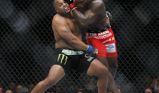 FILE - In this May 23, 2015, file photo, Daniel Cormier, left, and Anthony Johnson duel in the light heavyweight mixed martial arts title bout at UFC 187 on Las Vegas. UFC light heavyweight champion Cormier is set to fight Johnson in the main event of UFC 210. Cormier defeated Johnson in their first bout in 2015. The two headline Buffalo, N.Y's first UFC card since 1995. (AP Photo/John Locher, File)