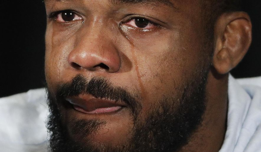 FILE - In this July 7, 2016, file photo, mixed martial arts fighter Jon Jones cries as he speaks during a news conference in Las Vegas. Former UFC light heavyweight champion Jon Jones is prepared to break his nine-month silence on Friday, April 7, 2017. On the eve of UFC 210, Jones is scheduled to address the media for the first time since July, when he was issued a one-year suspension following a positive drug test. (AP Photo/John Locher, File)
