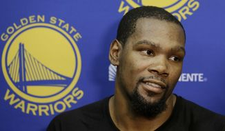 Golden State Warriors forward Kevin Durant speaks during NBA basketball practice in Oakland, Calif., Friday, April 7, 2017. (AP Photo/Jeff Chiu)