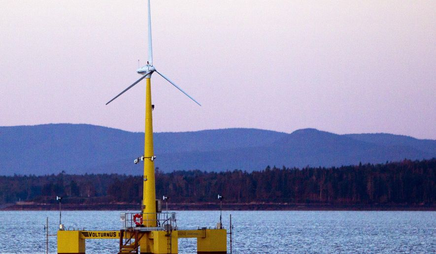 FILE - This Friday, Sept. 20, 2013 file photo shows the University of Maine's prototype wind turbine generator off the coast of Castine, Maine. A proposal before the Maine Legislature in 2017 would prevent the state from permitting an offshore wind energy project in the vicinity of Monhegan Island, about 12 nautical miles off of Maine's mainland and known as a home to artists, seasonal residents and lobster fishermen. (AP Photo/Robert F. Bukaty, File)