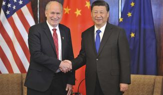 Chinese President Xi Jinping, right, and Alaska Governor Bill Walker greet each other at a meeting Friday, April 7, 2017, in Anchorage, Alaska. Xi requested time with Gov. Walker Friday night as the Chinese delegation's plane made a refueling stop in Alaska's largest city following meetings with President Donald Trump in Florida. (AP Photo/Michael Dinneen)
