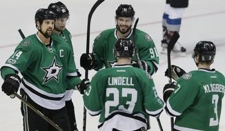 Dallas Stars center Tyler Seguin (91) celebrates his goal with teammates Jamie Benn (14), Jason Spezza (90), Esa Lindell (23) and John Klingberg (3) during the third period of an NHL hockey game against the Colorado Avalanche in Dallas, Saturday, April 8, 2017. The Stars won 4-3 in an overtime shootout. (AP Photo/LM Otero)