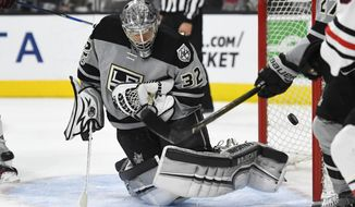 Los Angeles Kings goalie Jonathan Quick (32) is scored against by Chicago Blackhawks center Jonathan Toews during the first period of an NHL hockey game, Saturday, April 8, 2017, in Los Angeles. (AP Photo/Mark J. Terrill)