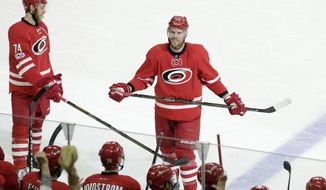 Carolina Hurricanes' Bryan Bickell (29) is acknowledged during the third period of an NHL hockey game against the St. Louis Blues in Raleigh, N.C., Saturday, April 8, 2017. Bickell is retiring after being diagnosed with multiple sclerosis. St. Louis won 5-4 in a shootout. (AP Photo/Gerry Broome)