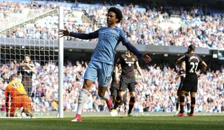 Manchester City's Leroy Sane, center, celebrates after an own goal from Hull City's Ahmed Elmohamady, right, during their English Premier League match at the Etihad Stadium, Manchester, England, Saturday, April 8, 2017. (Dave Thompson/PA via AP)