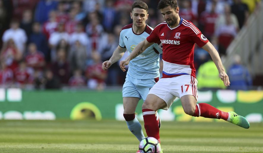 Middlesbrough's Antonio Barragan, right, and Burnley's Robbie Brady during their English Premier League soccer match at the Riverside Stadium in Middlesbrough, England, Saturday April 8, 2017. (Richard Sellers/PA via AP)
