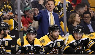 Boston Bruins head coach Bruce Cassidy talks to his players during the third period of their 3-1 loss to the Washington Capitals in an NHL hockey game in Boston, Saturday, April 8, 2017. (AP Photo/Winslow Townson)