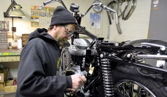ADVANCE FOR SATURDAY APRIL 8 AND THEREAFTER - In a March 29, 2017 photo, Don Nevins works on a 1969 BSA at Cycle Service. Nevins specializes in restoring classic British motorcycles like this one, for customers from all over the country.  (Joe Sutter/The Messenger via AP)