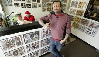 In this March 31, 2017 photo Owner Scotty Gyatso poses at Liberty Tattoo in Fairbanks, Alaska. (Eric Engman /Fairbanks Daily News-Miner via AP)