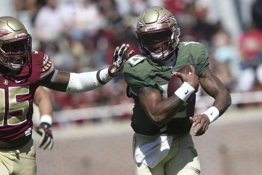 Florida State quarterback Deondre Francois scrambles away from Keith Bryant during the NCAA college football team's Garnet and Gold spring game in Tallahassee, Fla., Saturday, April 8, 2017. (Joe Rondone/Tallahassee Democrat via AP)