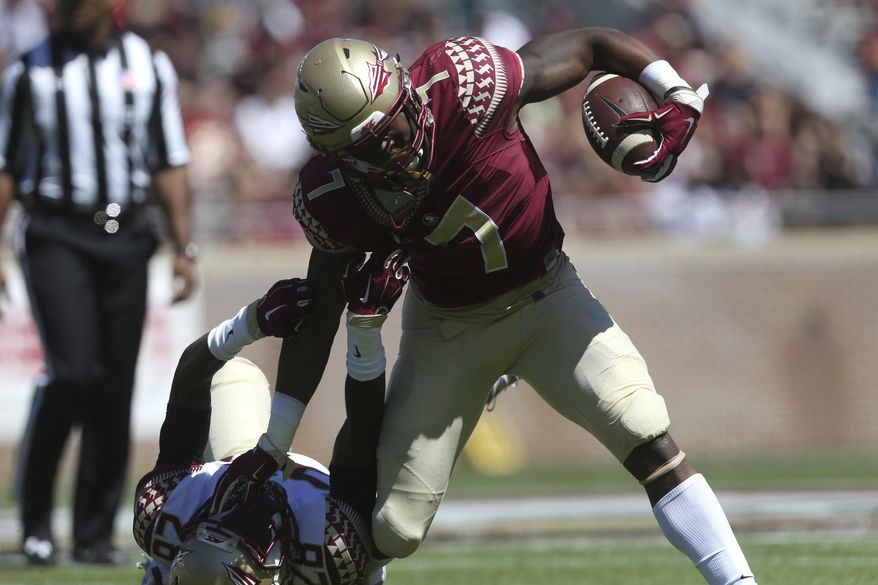 Florida State's Ryan Green tries to break away from Malique Jackson during the NCAA college football team's Garnet and Gold spring game on Saturday, April 8, 2017, in Tallahassee, Fla. (Joe Rondone/Tallahassee Democrat via AP)