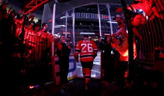 New Jersey Devils' Patrik Elias, right, leads the team onto the ice for warmups prior to an NHL hockey game against the New York Islanders, Saturday, April 8, 2017, in Newark, N.J. The Devils' all-time leading scorer is retiring after a career that spanned almost two decades and included two Stanley Cup titles. The 40-year-old native of the Czech Republic announced his retirement in a statement on Friday, March 31, 2017. (AP Photo/Julio Cortez)