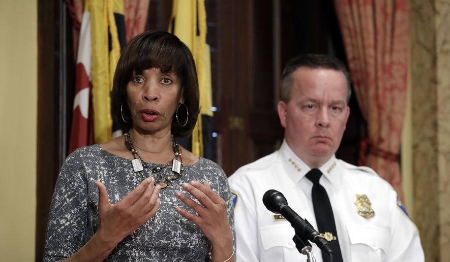In this Tuesday, April 4, 2017, file photo, Baltimore Mayor Catherine Pugh, left, speaks alongside Baltimore Police Department Commissioner Kevin Davis at a news conference at City Hall in Baltimore. On Jan. 11, 2018, Ms. Pugh announced that six buildings in the city's Gilmor Homes housing project would be demolished, calling them a hotbed for criminal activity. (AP Photo/Patrick Semansky, File)