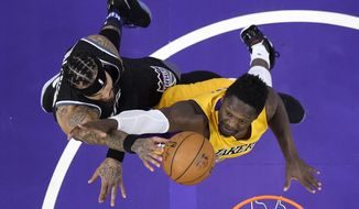 Sacramento Kings center Willie Cauley-Stein, left, shoots as Los Angeles Lakers forward Julius Randle defends during the first half of an NBA basketball game, Friday, April 7, 2017, in Los Angeles. (AP Photo/Mark J. Terrill)