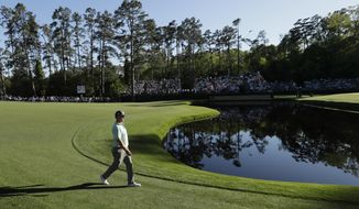 Charley Hoffman walks to the 15th green during the third round of the Masters golf tournament Saturday, April 8, 2017, in Augusta, Ga. (AP Photo/David J. Phillip)