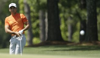 Jason Day of Australia, hits to the 17th green during the third round of the Masters golf tournament Saturday, April 8, 2017, in Augusta, Ga. (AP Photo/Charlie Riedel)