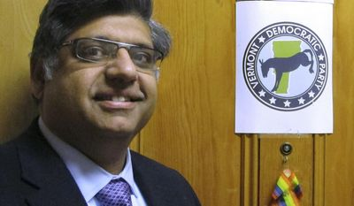 In this April 5, 2017 photo, Faisal Gill, newly elected chairman of the Vermont Democratic Party, poses at the door of the party's office in Montpelier, Vt.  Gill is a Pakistani-born lawyer believed to the be first Muslim to lead a state party in the U.S. (AP Photo/Lisa Rathke)