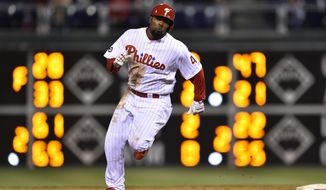 Philadelphia Phillies' Howie Kendrick rounds second base after hitting a three-run triple off Washington Nationals starting pitcher Jeremy Guthrie during the first inning of a baseball game, Saturday, April 8, 2017, in Philadelphia. (AP Photo/Derik Hamilton)
