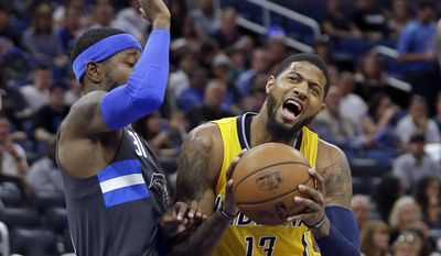 Indiana Pacers' Paul George (13) tries to get position to shoot against Orlando Magic's Terrence Ross, left, during the first half of an NBA basketball game, Saturday, April 8, 2017, in Orlando, Fla. (AP Photo/John Raoux)