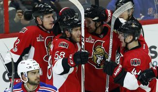 Ottawa Senators' Mike Hoffman (68) celebrates his goal against the New York Rangers with teammates Dion Phaneuf (2) Mark Stone (61) and Jean-Gabriel Pageau (44) during the second period of an NHL hockey game in Ottawa on Saturday April 8, 2017.  (Fred Chartrand/The Canadian Press via AP)