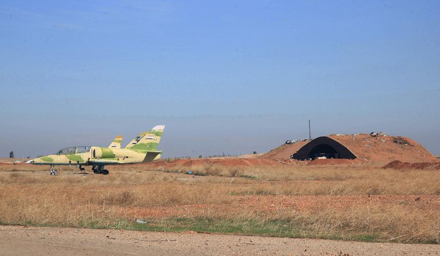 FILE - In this file photo released on Wednesday, Nov. 11, 2015 by the Syrian official news agency SANA, shows warplanes inside the Kweiras air base, east of Aleppo, Syria. A U.S. missile attack on Friday, April 7, 2017 has caused heavy damage to one of Syria's biggest and most strategic air bases, used to launch warplanes to strike opposition-held areas in central, northern and southern Syria. (SANA via AP, File)