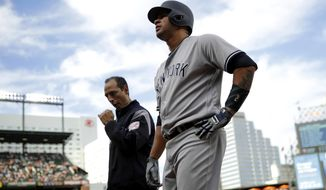 New York Yankees' Gary Sanchez walks off the field after injuring himself during an at-bat in the fifth inning of a baseball game against the Baltimore Orioles in Baltimore, Saturday, April 8, 2017. (AP Photo/Patrick Semansky)