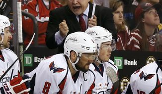 Washington Capitals head coach Barry Trotz talks to his players during the third period of Washington's 3-1 win over the Boston Bruins in an NHL hockey game in Boston Saturday, April 8, 2017. (AP Photo/Winslow Townson)