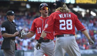 Washington Nationals' Ryan Zimmerman celebrates with Jayson Werth (28) after hitting a three-run home run off Philadelphia Phillies' Jeanmar Gomez during the ninth inning of a baseball game, Sunday, April 9, 2017, in Philadelphia. The Phillies won 4-3. (AP Photo/Derik Hamilton)
