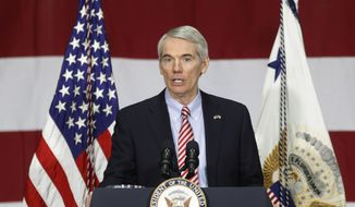 Sen. Rob Portman, R-Ohio, speaks before Vice President Mike Pence at DynaLab Inc., Saturday, April 1, 2017, in Reynoldsburg, Ohio. (AP Photo/John Minchillo) ** FILE **