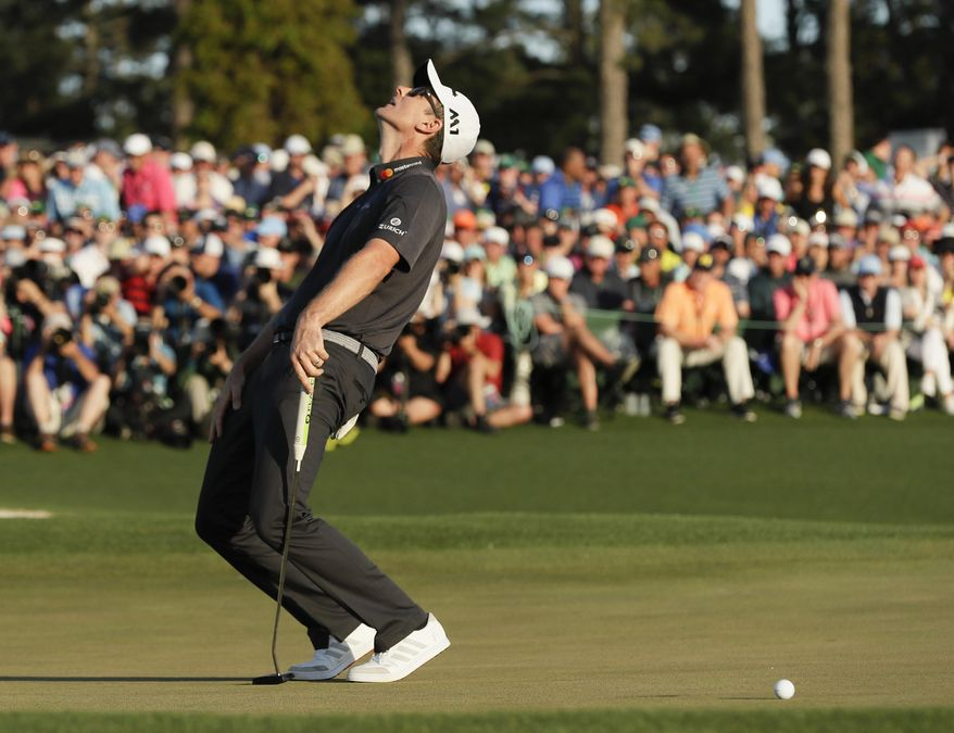 Justin Rose, of England, reacts after missing a birdie putt on the 18th hole during the final round of the Masters golf tournament Sunday, April 9, 2017, in Augusta, Ga. (AP Photo/David J. Phillip)