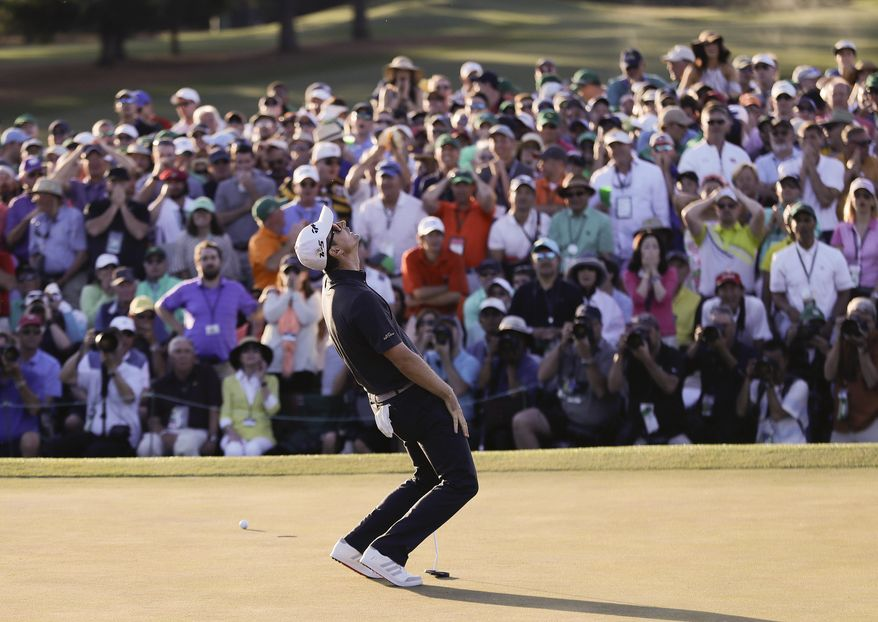 Justin Rose, of England, reacts after missing a birdie putt on the 18th hole during the final round of the Masters golf tournament Sunday, April 9, 2017, in Augusta, Ga. (AP Photo/David Goldman)