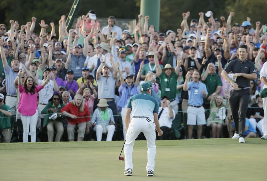 Justin Rose, of England, right, watches as Sergio Garcia, of Spain, reacts after making his birdie putt on the 18th green to win the Masters golf tournament after a playoff Sunday, April 9, 2017, in Augusta, Ga. (AP Photo/Charlie Riedel)