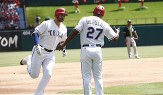 Texas Rangers' Joey Gallo, left,  is congratulated by third base coach Tony Beasley, right, after hitting a three-run home run against the Oakland Athletics in the second inning of a baseball game Sunday, April 9, 2017, in Arlington, Texas. (AP Photo/Mike Stone)
