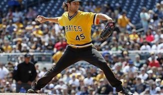 Pittsburgh Pirates starting pitcher Gerrit Cole delivers in the first inning of a baseball game against the Atlanta Braves in Pittsburgh, Sunday, April 9, 2017. (AP Photo/Gene J. Puskar)