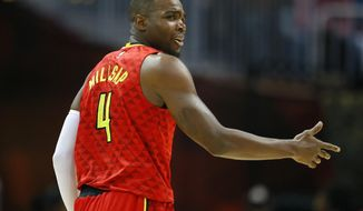 Atlanta Hawks forward Paul Millsap (4) reacts in the first half of an NBA basketball game against the Cleveland Cavaliers on Sunday, April 9, 2017, in Atlanta. The Hawks won in overtime 126-125. (AP Photo/Todd Kirkland)