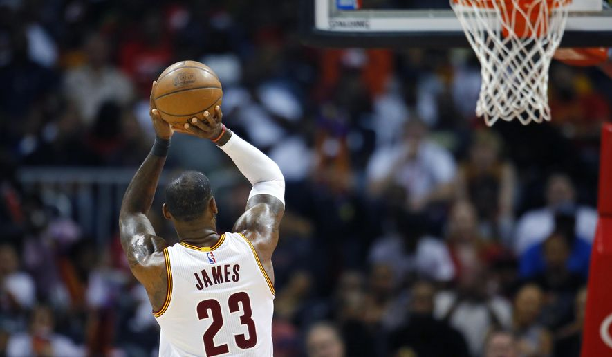 Cleveland Cavaliers forward LeBron James (23) shoots from the line in the first half of an NBA basketball game against the Atlanta Hawks, Sunday, April 9, 2017, in Atlanta. (AP Photo/Todd Kirkland)