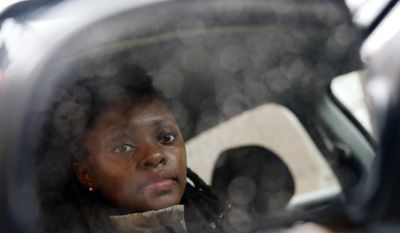 In this Wednesday, April 5, 2017 photo, Kara Bland sits in her car in Chicago. Bland's 2010 Chevy Malibu still had temporary plates when police seized it for a crime she did not commit. She loaned it to the father of her daughter, who was arrested after picking up someone who had marijuana on him. For six weeks, Bland took her daughter to school on a Chicago city bus and relatives helped her run errands before a judge released the car on bond. It took a total of nine months to officially regain ownership and cost her $1,000. (AP Photo/Nam Y. Huh)