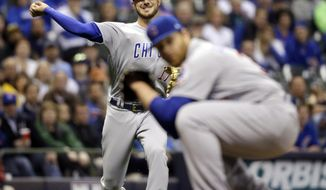Chicago Cubs' Kris Bryant throws out Milwaukee Brewers' Jesus Aguilar during the second inning of a baseball game Friday, April 7, 2017, in Milwaukee. (AP Photo/Jeffrey Phelps)