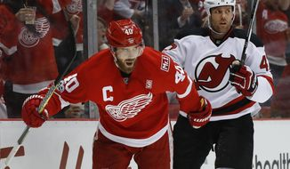 Detroit Red Wings left wing Henrik Zetterberg (40) celebrates his goal against the New Jersey Devils during the second period of the final NHL hockey game at Joe Louis Arena, Sunday, April 9, 2017, in Detroit. (AP Photo/Paul Sancya)