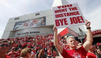 Hank Stawasz holds a sign as fans wait to enter the final NHL hockey game at Joe Louis Arena between the Detroit Red Wings and New Jersey Devils, Sunday, April 9, 2017, in Detroit. (AP Photo/Paul Sancya)