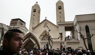 People gather outside the St. George's Church after a suicide bombing, in the Nile Delta town of Tanta, Egypt, Sunday, April 9, 2017. Bombs exploded at two Coptic churches in the northern Egyptian cities of Tanta and Alexandria as worshippers were celebrating Palm Sunday, killing over 40 people and wounding scores more in assaults claimed by the Islamic State group. (AP Photo/Nariman El-Mofty)