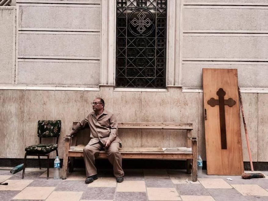 A man sits on a bench outside a church after a bomb attack in the Nile Delta town of Tanta, Egypt, Sunday, April 9, 2017. The attack took place on Palm Sunday, the start of the Holy Week leading up to Easter, when the church in the Nile Delta town of Tanta was packed with worshippers. (AP Photo/Nariman El-Mofty)