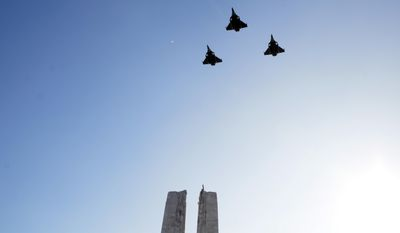 The French armed forces perform a flypast during a ceremony marking the 100th anniversary of the Battle of Vimy Ridge at the WWI Canadian National Vimy Memorial in Givenchy-en-Gohelle, France on Sunday, April 9, 2017. The commemorative ceremony at the memorial honors Canadian soldiers who were killed or wounded during the Battle of Vimy Ridge in April 1917. (AP Photo/Virginia Mayo)