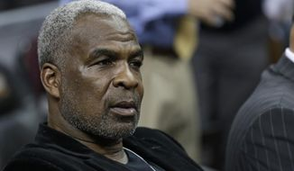 FILE - In this Feb. 23, 2017 file photo, former New York Knicks player Charles Oakley waits for an NBA basketball game to begin between the New York Knicks and the Cleveland Cavaliers, in Cleveland. Oakley is set for his day in court Tuesday, April 11, 2017, in the wake of his arrest at a Knicks game at Madison Square Garden in February. Oakley was charged with three counts of misdemeanor assault and one count of criminal trespass. (AP Photo/Tony Dejak, File)