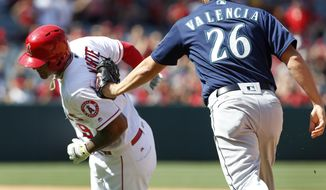 Los Angeles Angels' Jefry Marte (19)is tagged out by Seattle Mariners' Danny Valencia (26) in the seventh inning of a baseball game, Sunday, April 9, 2017, in Anaheim, Calif. (AP Photo/Christine Cotter)