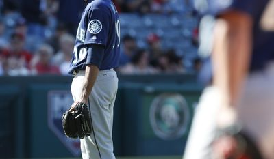 Seattle Mariners relief pitcher Edwin Diaz looks toward home plate after giving up a run in the ninth inning of a baseball game against the Los Angeles Angels, Sunday, April 9, 2017, in Anaheim, Calif. The Angels won 10-9 (AP Photo/Christine Cotter)