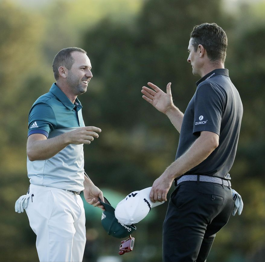 Sergio Garcia, of Spain, talks to Justin Rose, of England, after making his birdie putt on the 18th green to win the Masters golf tournament after a playoff Sunday, April 9, 2017, in Augusta, Ga. (AP Photo/Chris Carlson)