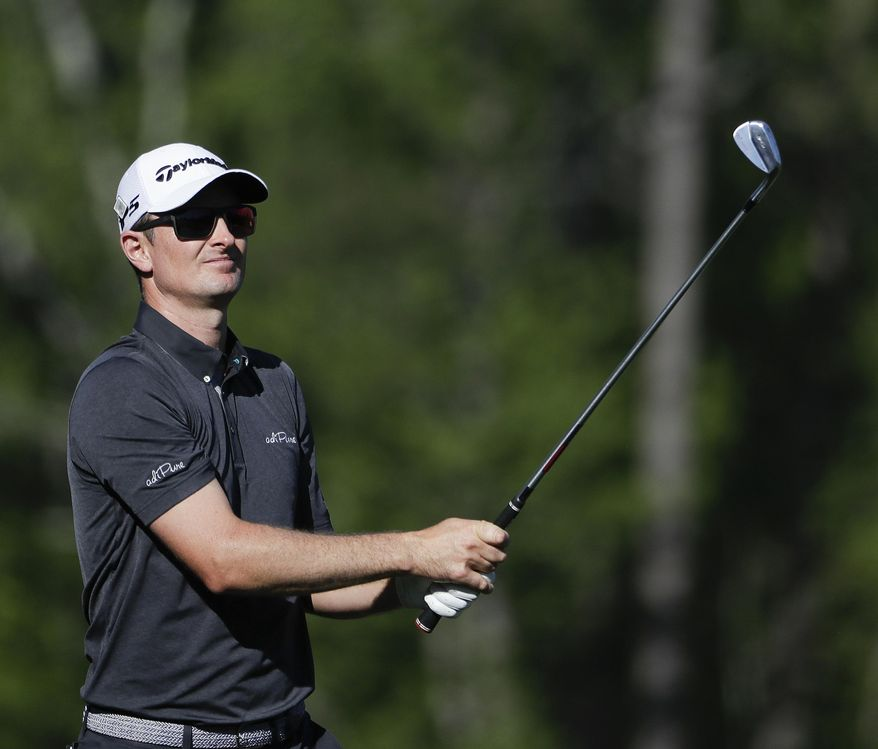 Justin Rose, of England, hits a shot on the 12th hole during the final round of the Masters golf tournament Sunday, April 9, 2017, in Augusta, Ga. (AP Photo/David Goldman)