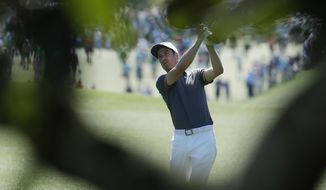 Ross Fisher of England, hits a shot on the first hole during the final round of the Masters golf tournament Sunday, April 9, 2017, in Augusta, Ga. (AP Photo/Chris Carlson)